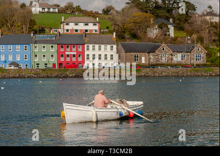 Fisherman rowing a boat in Bantry Harbour, West Cork, Ireland. - Stock Image