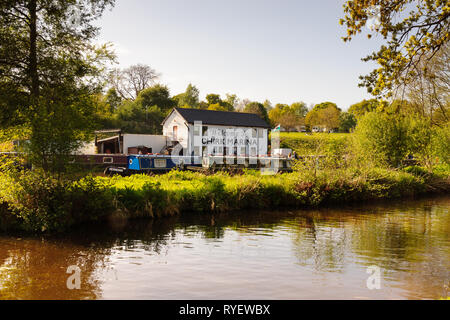 Chirk Marina with narrowboats moored up a boat hire repair fuelling and maintenance centre on the Llangollen canal in Chirk North Wales - Stock Image