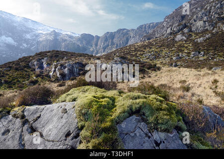 The so-called Devil's Kitchen is at the head of Cwm Idwal (a cirque or corrie) in the Glyderau Range of the Snowdonia National Park. - Stock Image