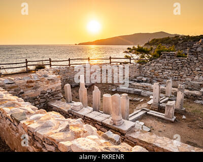 Ancient ruins at Aliki marble quarry in sunrise light, Thassos, Greece. Lens flare visible - Stock Image