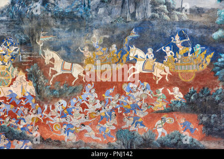 One of the many murals inside the Royal Palace in Phnom Penh, Cambodia, depicting battles between religious characters. - Stock Image
