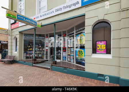 A news agent or newspaper and magazine shop or store in the New South Wales south coast town of Milton in Australia - Stock Image