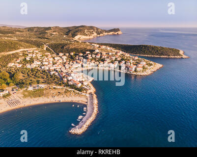 Thasos Island Skala Marion traditional village, harbour and beach as seen at sunset from above in the Aegean Sea - Stock Image