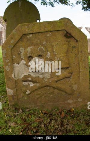 unnamed deaths head gravestone found in Kirkoswald Kirk Ayrshire Scotland - Stock Image