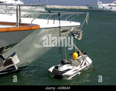 Jet ski attached to yacht, Puerto Banus, Costa del Sol, Spain - Stock Image
