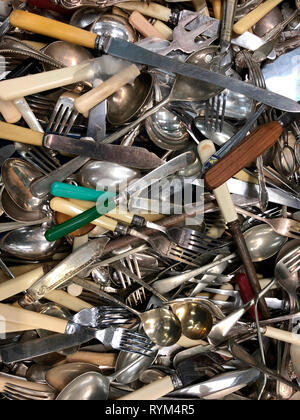 Pile of old cutlery - knives - forks - spoons - Stock Image