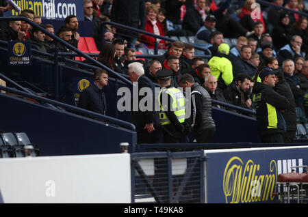 Hampden Park, Glasgow, UK. 14th Apr, 2019. Scottish Cup football, semi final, Aberdeen versus Celtic; Aberdeen Manager Derek McInnes is escorted up the tunnel after being ordered to the stand by referee Craig Thomson Credit: Action Plus Sports/Alamy Live News - Stock Image