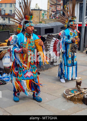 Street musicians in South American costume singing and playing pan pipes in Whitby town centre - Stock Image