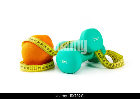 healthy eating and active lifestyle concept - dumbbells with orange and measuring tape - Stock Image