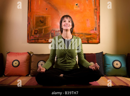 A yoga instructor in Fayetteville, Arkansas, U.S.A. - Stock Image
