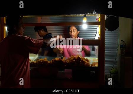 Food stall on Ubud's main street Jalan Raya Pejeng, Bali Indonesia - Stock Image