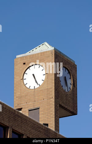 Outdoor clock on the The Clock Tower building at the corner of Wes Broadway and Granville Street in Vancouver, BC, Canada - Stock Image