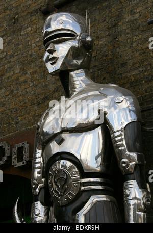 Large Statue of a Male Cyborg Outside Cyberdog Shop in Camden Market, London, UK - Stock Image
