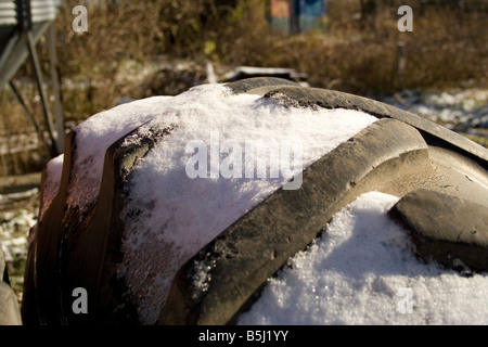 The top of a snow covered Tractor Tire - Stock Image