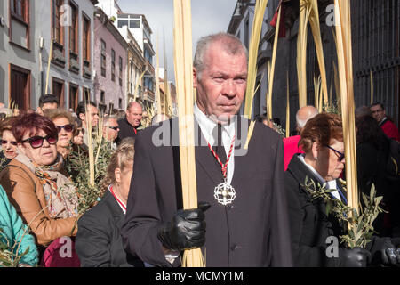 Tenerife, Canary Islands, church officials carrying palms during the Palm Sunday Holy Week procession through the streets of La Laguna. - Stock Image