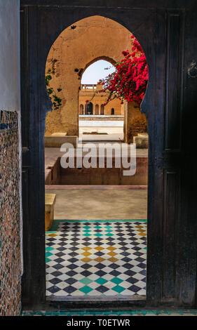 Looking through doors in the Medina of Marrakech, Morocco - Stock Image