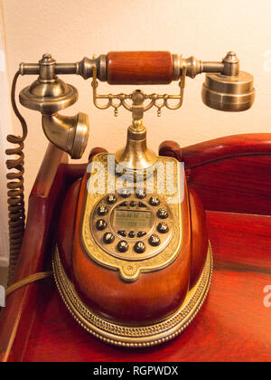 Attractive antique telephone receiver red wood and gilt decoration - Stock Image