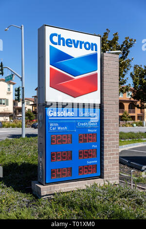Chevron sign with gasoline and car wash prices; Sunnyvale, California, USA - Stock Image