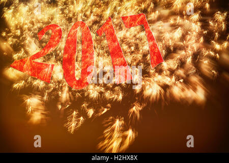 Red numbers 2017 golden fireworks in evening sky. New Years Eve Day concept. Proportions shrink to 5x7 for a greeting - Stock Image