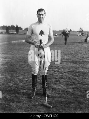Gerald Balding of the Greentree Polo Team poses holding a polo mallet and helmet, ca 1934 - Stock Image