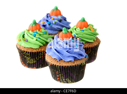 Pumpkin spice cupcakes with vanilla buttercream in Halloween inspired liners decorated with a candy pumpkin - Stock Image