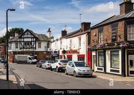Allerton Road Woolton Liverpool, featuring The Grapes public house, Thomas Porter and Sons Ltd funeral directors and the King Do Chinese restaurant. - Stock Image