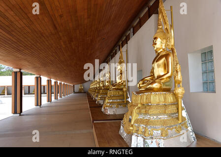 Wat Thamayan - some of the Buddha statues in the central courtyard of this stunningly beautiful modern temple in Central Thailand - Stock Image