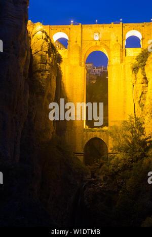 Bridge called Puente Nuevo  in night time.   Ronda, Spain - Stock Image