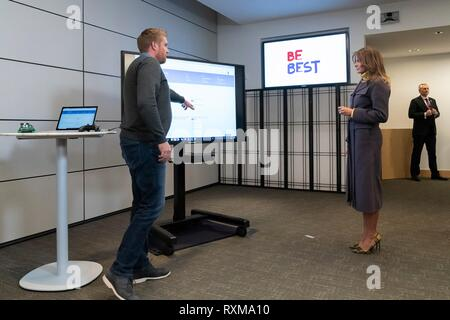 U.S First Lady Melania Trump listens to an Xbox parental controls and accessibility presentation by Dave McCarthy, Microsoft Corporate Vice President of Xbox Operations at the Microsoft Executive Briefing Center March 4, 2019 in Redmond, Washington. - Stock Image