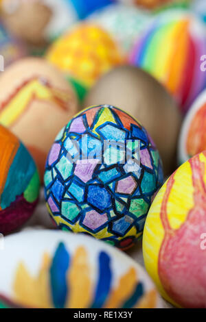 Detail of painted Easter eggs with different forms, cartoons and bright colors. - Stock Image