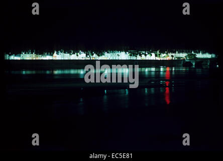 city lights reflected in the river at night - Stock Image
