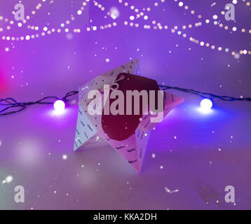 Christmas Decoration with star gift  box with golden bokeh garland and christmas lights for holidays best background - Stock Image