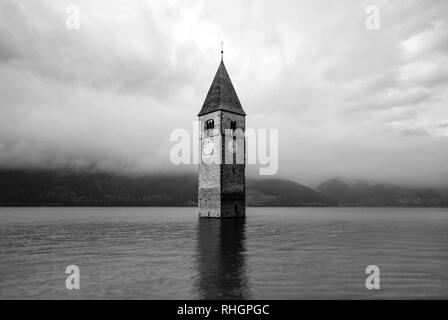 The top of the old bell tower of Curon Venosta village - Italy - emerges from the water - Stock Image