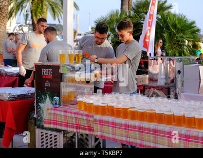 Split Croatia, April 25, 2019 : After the finish line at B2Run Business race,Volunteers setting up the beer table for race finishers - Stock Image