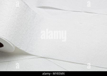 Closeup of rolls of overlapping toilet paper - Stock Image