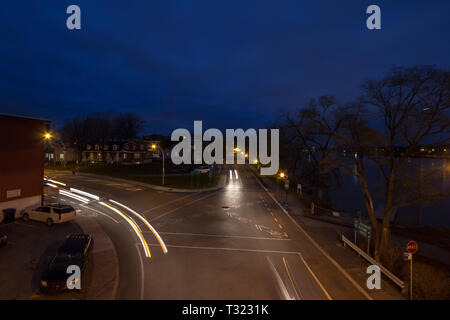 LAVAL, CANADA - NOVEMBER 9, 2018: Residential street at a crossroad in a suburban street, typical from North America, in Laval, in the outskirts of Mo - Stock Image