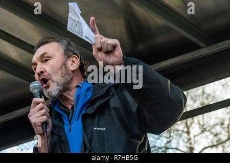 London, UK. 9th Dec, 2018. NEU General Secretary Kevin Courtney speaks at the rally by united anti-fascists in opposition to Tommy Robinson's fascist pro-Brexit march. The protest by both remain and leave supporting anti-fascists gathered at the BBC and marched to a rally at Downing St. Police had issued conditions on both events designed to keep the two groups well apart. Credit: Peter Marshall/Alamy Live News - Stock Image