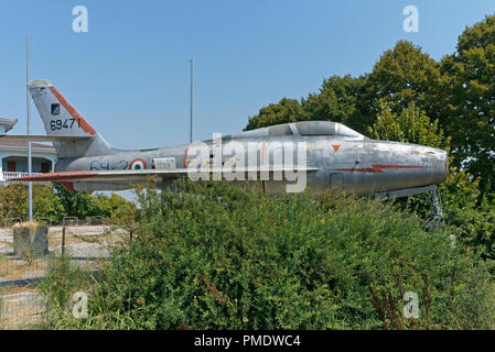 dismissed jet fighter abandoned in a field, Italy - Stock Image