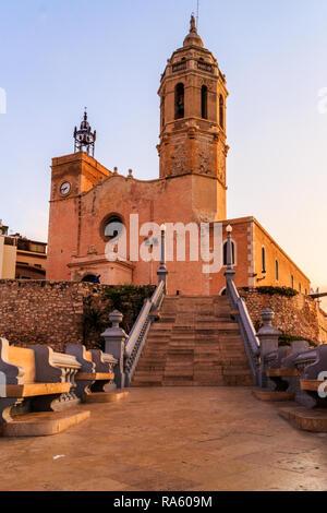 Parish church of Saint Bartholomew and Santa Tecla at sunrise, Sitges, Spain - Stock Image
