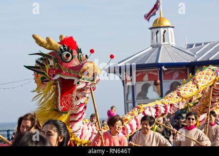 Eastbourne, UK. 17th Feb 2019. A Chinese dragon is paraded on the streets of Eastbourne as part of todays Chinese New Year celebrations, East Sussex.  Credit: Ed Brown/Alamy Live News - Stock Image