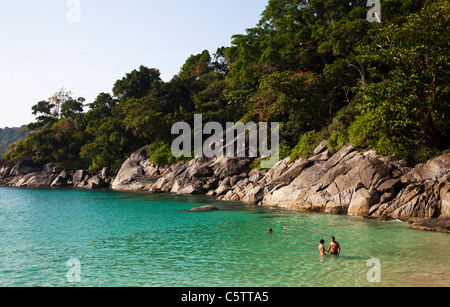 Freedom Beach and people swimming in the Andaman Sea . - Stock Image