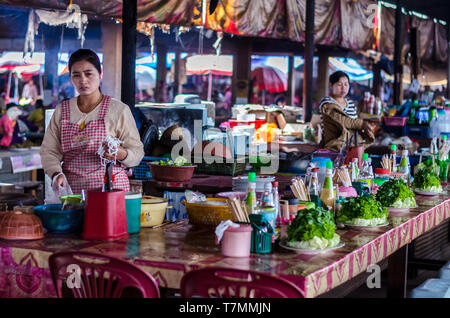 A traditional restaurant at the market in Luang Namtha, Laos - Stock Image