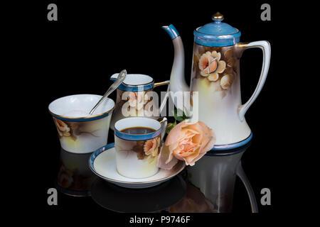 Vintage Noritake bone china coffee service circa 1904 on a black background. - Stock Image