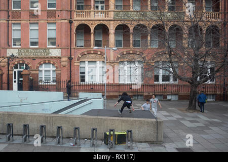 A youth leaps over concrete outside the concrete surface of a walkway at Waterloo, London.     on 5th March 2019, in London, England. - Stock Image