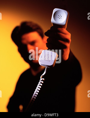 man holding a phone - Stock Image