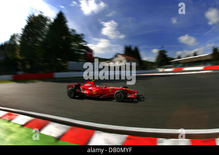 Finnish Formula One pilot Kimi Raikkonen of Scuderia Ferrari steers his car through a curve during the second practice - Stock Image
