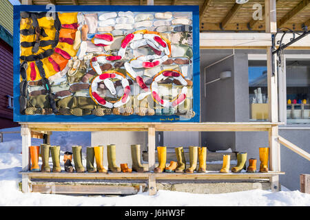 Mural and selection of colourful boots outside 'once Upon a Dream' gift shop in Honningsvåg, Finnmark - Stock Image