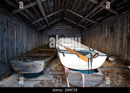Rowing boats in a boat shed. - Stock Image
