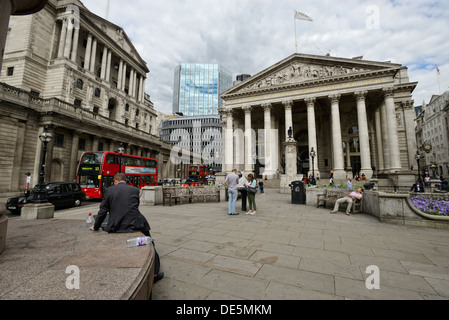 London street on a typical day in the City of London during summer, with tourists and office workers - Stock Image