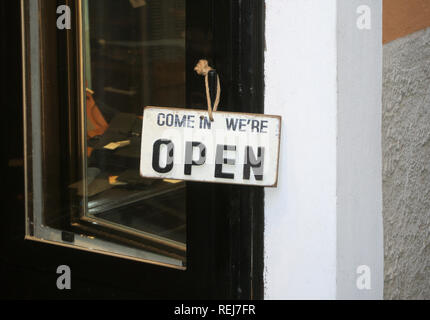 Come in we're open sign on a shop's door - Stock Image